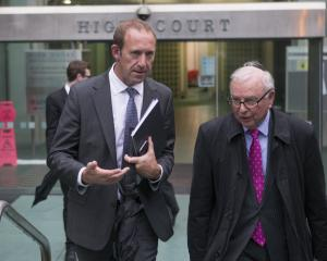 Labour leader Andrew Little leaving the Wellington High Court with his lawyer, John Tizard. Photo...
