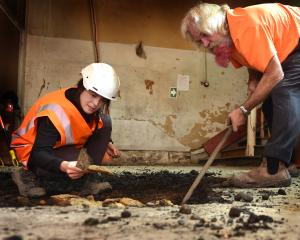 Archaeologist Phoebe Scrivener and Zeal Land's Alan Bryan look at artefacts dug up in the...