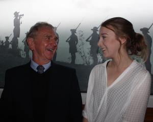 One of the recipients of the Clutha District RSA Welfare Trust's tertiary scholarships, Brodie Smith (18), with her ''Poppa'' Jim Fiddes, at the ceremony where she received the grant, following the dawn service yesterday. Photo: Samuel White.