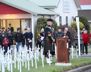Alex McLaughlin addresses the crowd at the Balclutha Anzac Dawn Service. PHOTO: SAMUEL WHITE