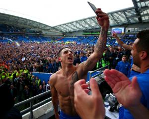 Anthony Knockaert of Brighton takes a selfie during the celebrations after the team was promoted...