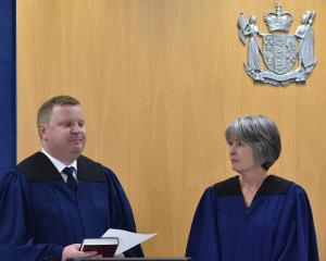 David Robinson is sworn in as a coroner by chief coroner Judge Deborah Marshall. Photo: Gregor...