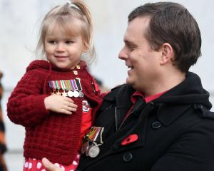 Richard Hancox and his daughter Issy (2) display his grandfather's World War 2 medals. Photo: Stephen Jaquiery.