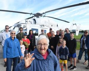 Alma McRobbie celebrates her 100th birthday in Mosgiel with her first helicopter ride yesterday. Photo: Stephen Jaquiery.