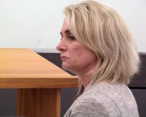 Margaret Denise Kronfeld in the Dunedin District Court during her trial on harassment charges....