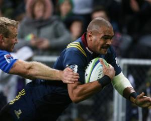 Patrick Osborne dives to score one of two tries in his 50th game for the Highlanders against the...