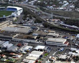 The extensive land area of the former Hillside Engineering Workshops is shown at the centre of this 2011 photograph, with Carisbrook in the background. Photo from ODT files.