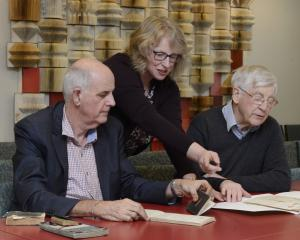 Friends of the Hocken Collections member Nigel Harwood (left), Hocken archives head curator Anna...