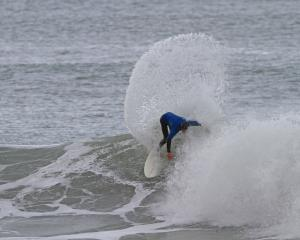 Luke Murphy rides a wave on the way to winning the South Island surfing title at Aramoana on...