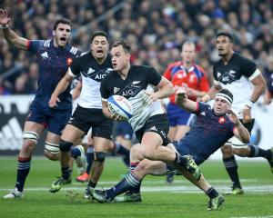 Israel Dagg looks to pass during last year's encounter between the All Blacks and France. Photo:...