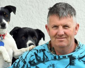 Kev Bonney at home in Dunedin this week with his dogs. Photo: Stephen Jaquiery.