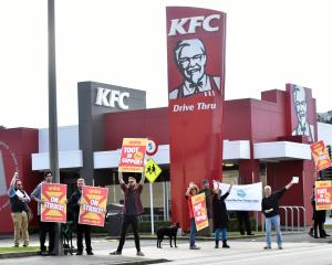 KFC staff strike outside the fast food outlet in North Dunedin on Saturday. Photo: Peter McIntosh.