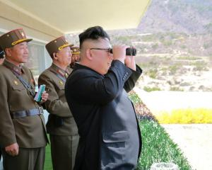 North Korean Leader Kim Jong Un observes a target-striking contest by the Korean People's Army. Photo: Reuters