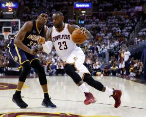 Cleveland Cavaliers forward LeBron James drives past Indiana Pacers forward Myles Turner in the...