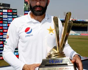 Misbah ul-Haq with the trophy for beating the West Indies in their test series in November last...