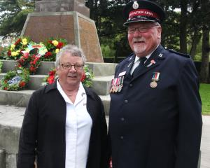 The Salvation Army's Ann and Bruce Heather beside the Hampden War Memorial. Photo: Shannon Gillies.