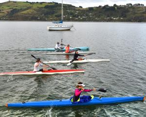 Members of the Otago Kayak Racing Club (from front) Anaia Wiparata (15), Alex Bristow (19), Lucy Matehaere (16), Brendan O'Neill and Graeme Newton pass the Ravensbourne boating club during a training session on Easter Monday morning. Photo by Gregor Richa