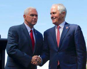 Pence shakes hands with Turnbull after a media conference at Admiralty House in Sydney. Photo: Reuters