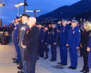 Queenstown Mayor Jim Boult (front left) and New Zealand Police Commissioner Mike Bush (left) were among the dignitaries at the Queenstown dawn service by Queenstown's Memorial Gates on the waterfront. PHOTO: GUY WILLIAMS