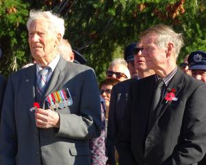 World War 2 navy veteran Allan Fisher (left), of Arrowtown, stands with former Arrowtown ward councillor Lex Perkins during the wreath-laying ceremony at the Arrowtown War Memorial yesterday. Photo: Guy Williams.