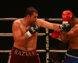 Razvan Cojanu fights New Zealand's Paula Mataele in 2013. Photo: Getty Images