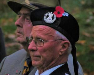 Teviot Valley veterans Forbes Knight (left) and Ken Bain take a few emotional moments to remember, during the Roxburgh service on ANZAC Day. PHOTO YVONNE O'HARA
