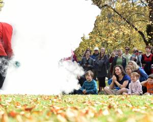 "More than 200 people watch as science communicator Amadeo Enriquez-Ballestero creates a ""storm'' using liquid nitrogen and boiling water at the Dunedin March for Science on the Museum Reserve on Saturday. Photo: Peter McIntosh."