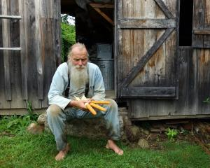 Will Bonsall, of Scatterseed Project, outside his barn with a rare variety of corn saved from a...