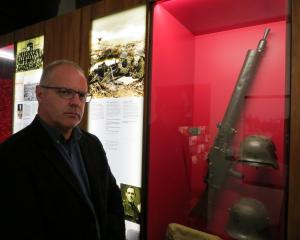 Toitu Otago Settlers Museum curator Sean Brosnahan believes the machine gun, used to devastating effect by German soldiers, was the decisive factor in the battles at Ypres and Passchendaele. Photo: Brenda Harwod
