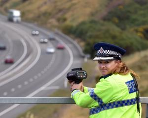 Southern district road policing manager Inspector Tania Baron operates a radar gun from an overbridge on Dunedin's Southern Motorway yesterday. Photo by Peter McIntosh.