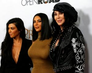 "Cher poses with television personalities Kim Kardashian and Kourtney Kardashian at the premiere of ""The Promise"". Photo: Reuters"