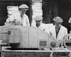 Disabled soldiers in the Lord Roberts Memorial Workshops in Britain make tanks as Christmas toys....