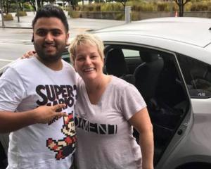 "Lisa Kottke, her husband Matt, and ""hero"" Uber driver Harpal Kang who drove them from Auckland to Wellington over nine and a half hours for an urgent meeting after flights were cancelled due to Cyclone Debbie. Photo: NZ Herald"