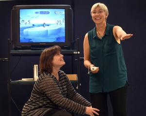 School of Physiotherapy lecturer Dr Cathy Chapple (left) shows Jane Terry how to use a Wii Fit console. Photo by Peter McIntosh.