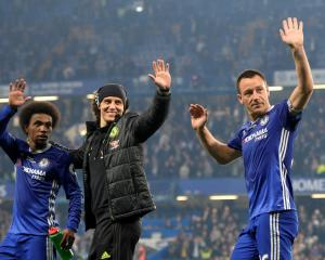 Chelsea players (from left) Willian, David Luiz and John Terry celebrate after the match. Photo:...