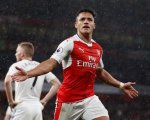 Alexis Sanchez celebrates scoring the second goal for Arsenal. Photo: Reuters