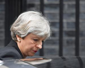 British Prime Minister Theresa May leaves 10 Downing St in London. Photo Reuters