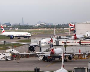 British Airways planes on the ground at Heathrow Terminal 5 in London. Photo Reuters