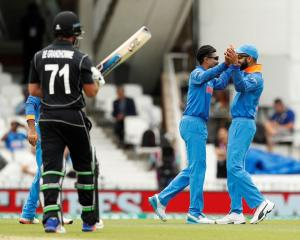 India's Ravindra Jadeja (C) celebrates the wicket of New Zealand's Colin de Grandhomme. Photo:...