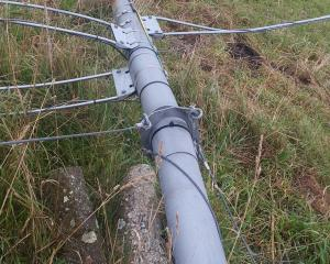A wind farm data collection tower toppled by vandals near Blueskin Bay, had its equipment broken and guy wires severed. Photo: Supplied.