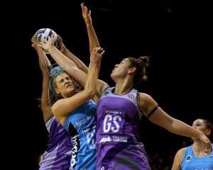 Steel goal keep Jane Watson (left) and Stars goal shoot Maia Wilson compete for the rebound...