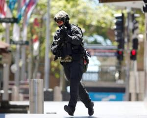 A police officer at the scene during the siege in Sydney. Photo Reuters