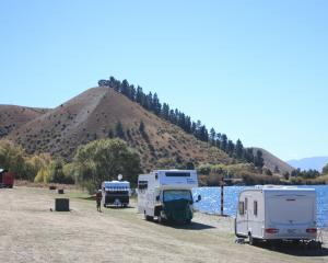 Caravans and camping vehicles parked on the shore of Lake Dunstan at Lowburn, near Cromwell. ...