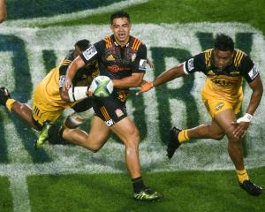 Chiefs centre Anton Lienert-Brown passes the ball during the team's match against the Hurricanes....