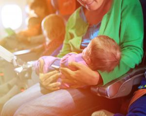 Jetstar is introducing a fare for babies held on laps. Photo: Getty