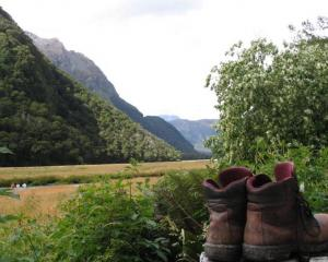 Boots dry out at a Routeburn Track hut after a hard day. Photo ODT