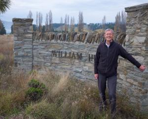 Alexandra property developer Russell Ibbotson at the gate of his planned subdivision. Photo:...