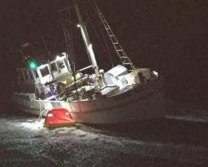 Fisherman have been rescued after running aground off a West Coast beach. Photo: Supplied/NZ Herald