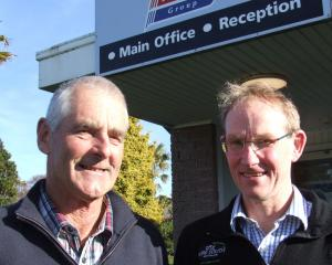 Retiring Alliance Group Pukeuri foreman butcher Chris McLeod (left) and plant manager Ivan...