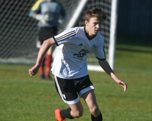 Shar Thorn, of Roslyn-Wakari, looks to pass in the Chatham Cup match against Invercargill Thistle...